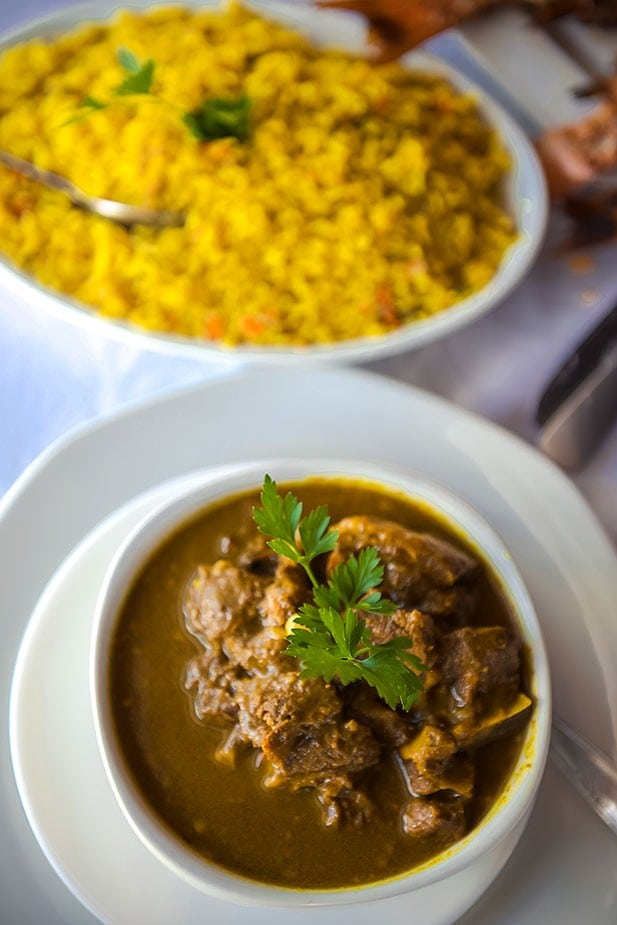 Goat Colombo is a dish specific to Guadeloupe that readers can order while visiting the island. Photo: Guadeloupe Tourism Board