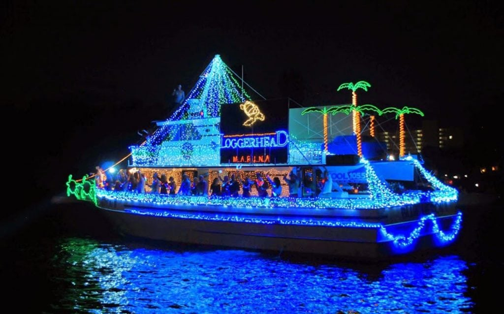 Loggerhead Marina Grand Marshal boat at the 2014 Palm Beach Holiday Boat Parade. This boat featured a marine and ocean conservation awareness theme with sea turtles swimming along each side of the 72' Blue Heron II. These turtles set the pace for a spectacular parade with traveling fireworks along the Intracoastal! Photo Leonard Bryant.