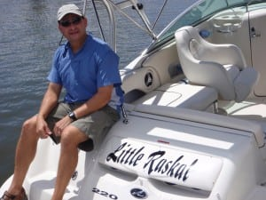"Raul Bermudez relaxing aboard his ""Little Raskal."""
