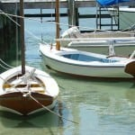 Dinghies tied to the dock at Abaco. Tips for Anchoring in the Bahamas.