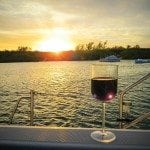 an image of a glass of wine on a boat in Man-O-War Cay
