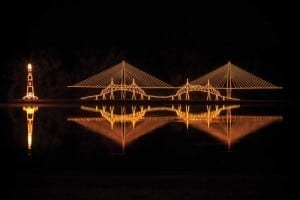 Festive lights illuminate a Charleston bridge. Photo credit: Bluewater Movements