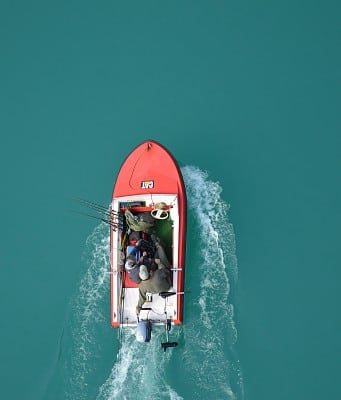 An image of a flats boat skimming the water