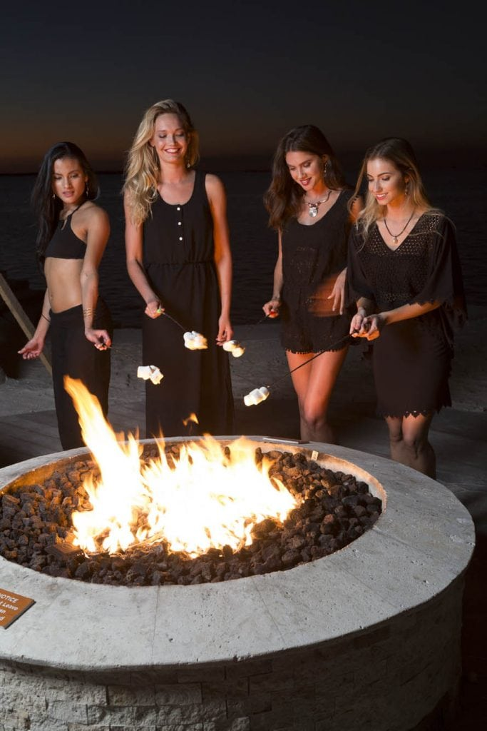 Four models roast marshmallows at the Playa Largo Resort and Spa