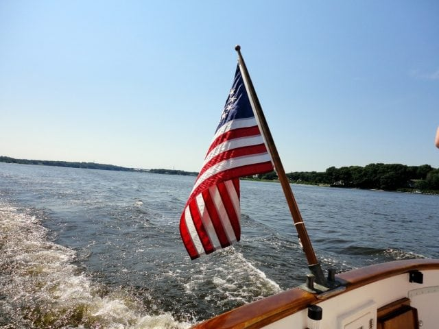 an image of an American flag on the back of a boat
