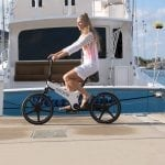 Tasha cruising on a Gocycle through RWB's marina