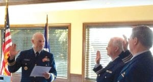 This is an image of Thomas M. Stokes, Sr. (middle) being sworn in as the new division commander.