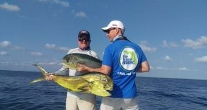 An image of two men with mahi during license free fishing in florida