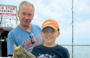 an image of a father and son fishing fluke
