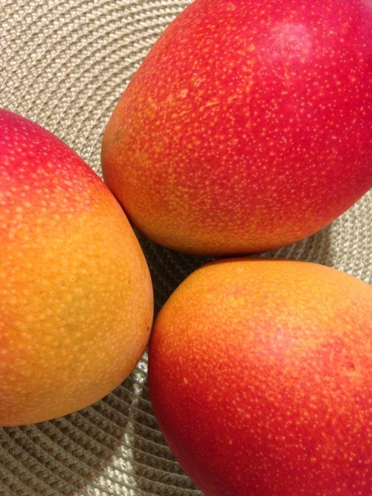 an image of mangos for Mango Salsa