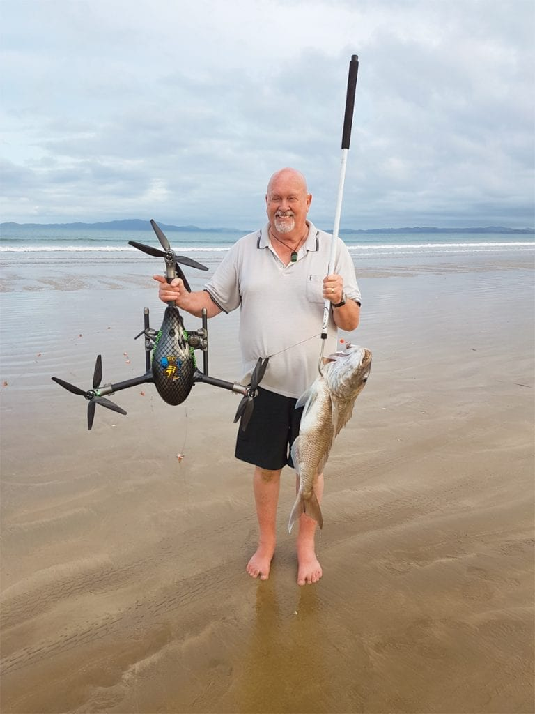 an image of a man drone fishing